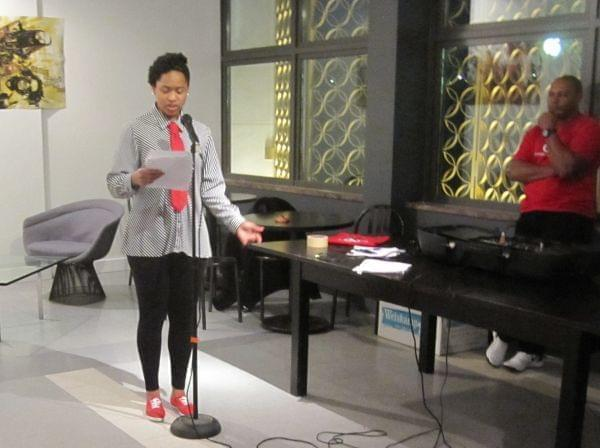 Coco Harmon reads some of her work, including a poem in honor of her mother, at the SPEAK Cafe.