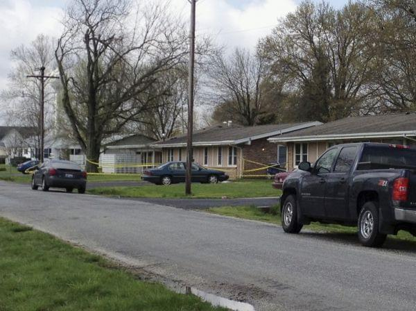 Police tape is seen around a house in Manchester, Ill., Wednesday, April 24, 2013, where the bodies of five people were found slain early Wednesday in the tiny southwestern Illinois town. Authorities said a suspect was injured and taken into custody.