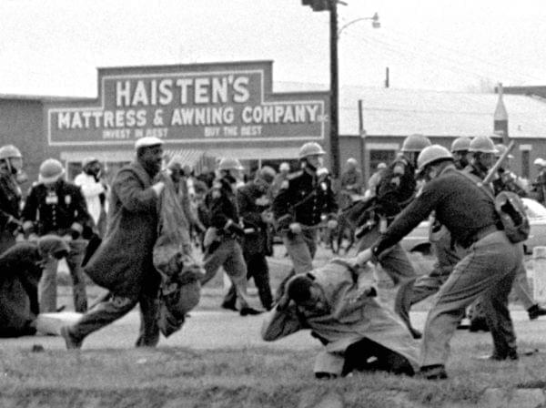 State troopers swing billy clubs to break up a civil rights voting march in Selma, Ala., on March 7, 1965. John Lewis, then-chairman of the Student Nonviolent Coordinating Committee (in the foreground) is being beaten by state troopers.