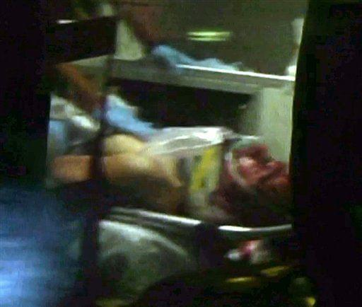This still frame from video shows Boston Marathon bombing suspect Dzhokhar Tsarnaev visible through an ambulance after he was captured.