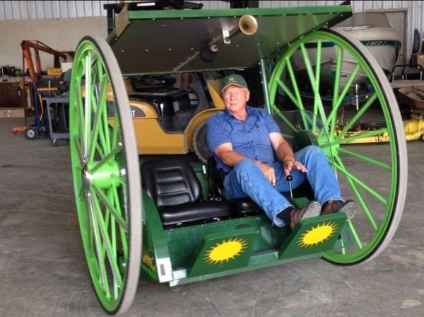 Larry Yoder showing off an earlier prototype of his solar powered buggy..
