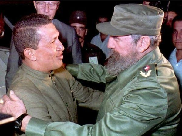 Cuban President Fidel Castro greets Chávez upon his arrival in Havana on Dec. 13, 1994. The two leaders were steadfast allies.