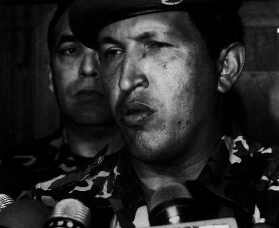As a lieutenant colonel in 1992, Chávez led a failed attempt to oust President Carlos Andres Perez. Here he talks to reporters at the Defense Ministry after he surrendered to troops loyal to the president.