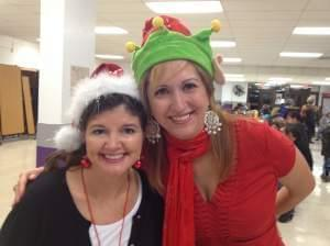 Angie Gentry and Lupita Garcia at a Christmas party for students and parents at Arcola Elementary School.