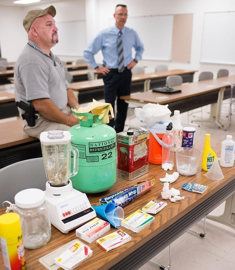 Vermilion County Sheriff's deputy Patrick Alblinger and Illinois State Police Master Sgt. Mike Atkinson (right) talk about the area's meth problem and show examples of lab components on Sept. 30, 2013.