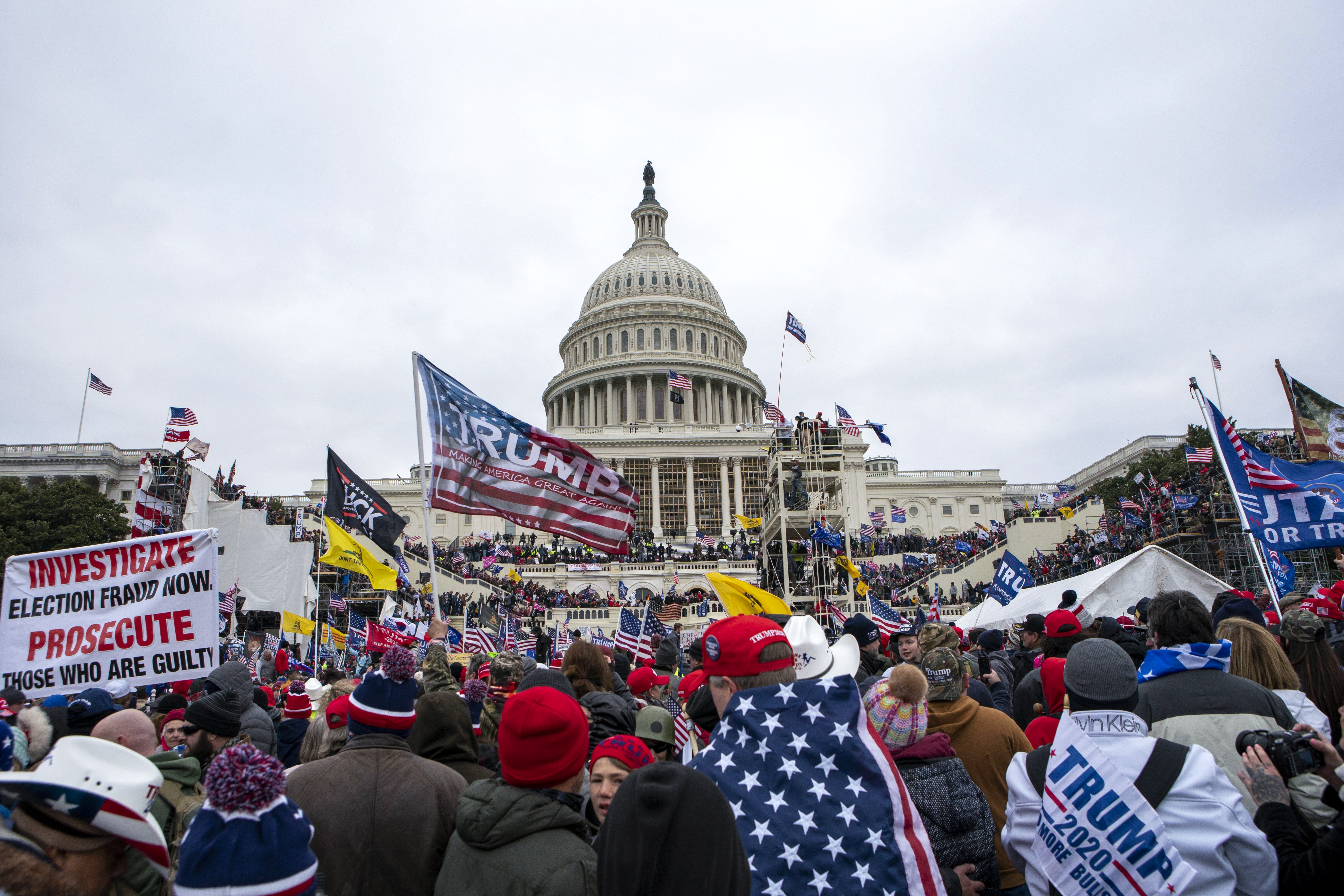 Supporters of President Donald Trump rally at the U.S. Capitol on Wednesday, Jan. 6, 2021, in Washington. (