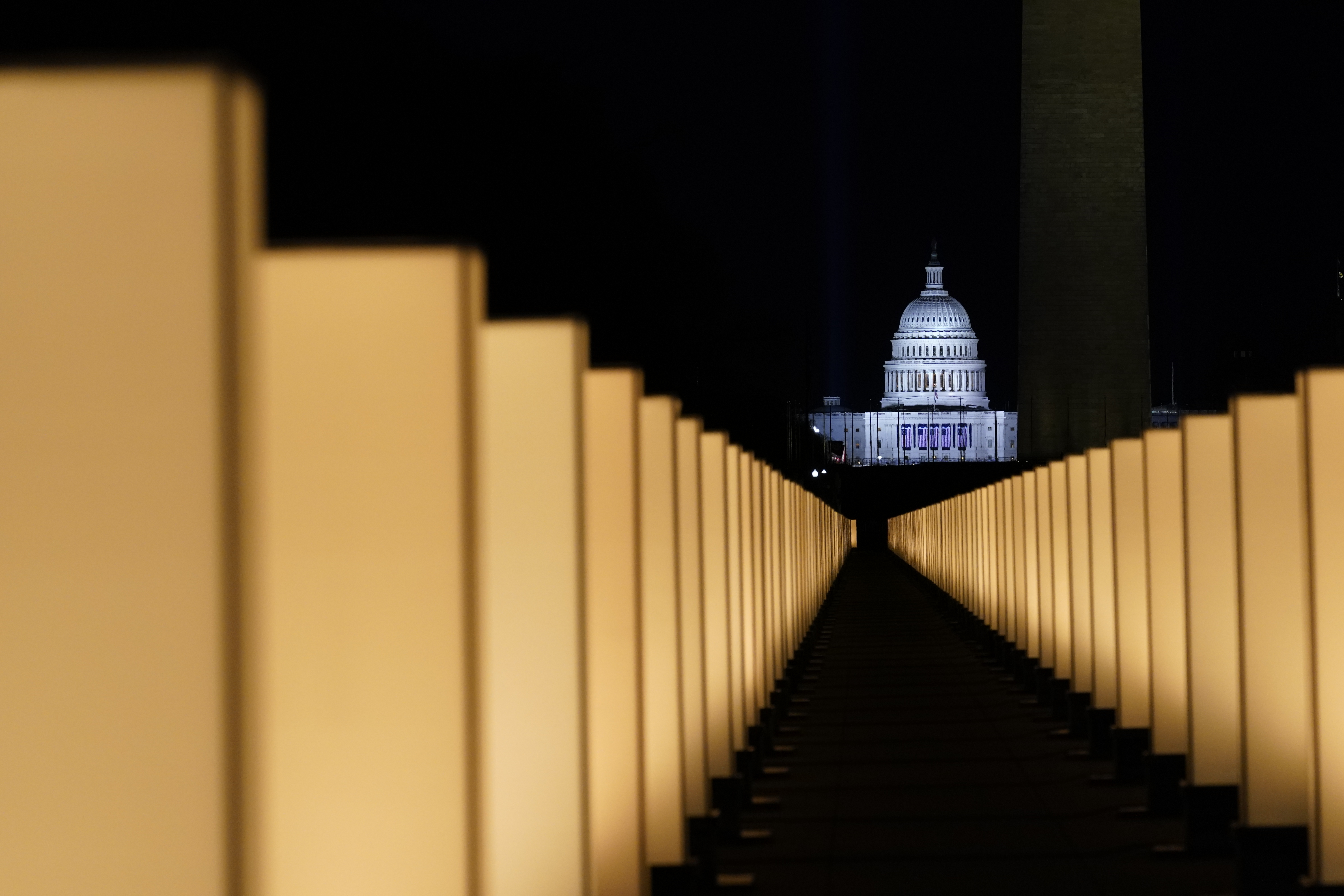 Lights surround the Lincoln Memorial Reflecting Pool, placed as a memorial to COVID-19 victims Tuesday, Jan. 19, 2021, in Washington, after President-elect Joe Biden spoke, with the U.S. Capitol in the background.