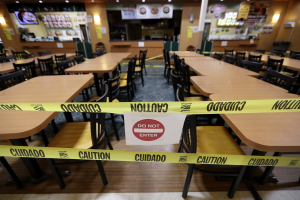 The seating area is closed-off at a food court in Assi Plaza during the coronavirus outbreak, Friday, April 3, 2020, in Niles, Ill. All bars, gyms, movie theaters, food courts to close, and restaurants are to move to drive-thru during the COVID-19 pandemic.