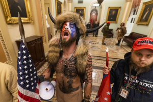 A supporter of President Donald Trump chants outside the Senate Chamber inside the Capitol, Wednesday, Jan. 6, 2021 in Washington.