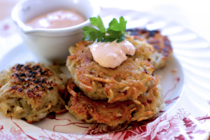 This Oct. 26, 2015 photo shows latkes with chipotle sour cream in Concord, NH. These crispy little potato pancakes make a wonderful appetizer or a great side dish all year long.