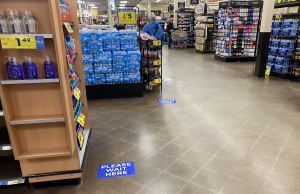 Stickers on the floor of a Kroger in Bloomington, Indiana, show how far apart customers should stand in checkout lines.