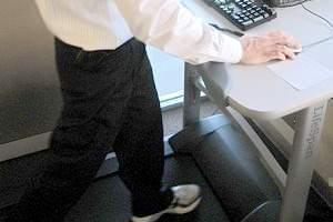Carle Spokesman Sean Williams works out on the treadmill in his department.