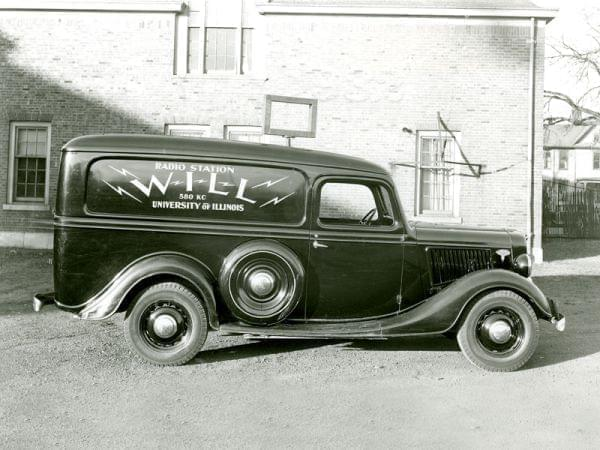 A 1930s-vintage WILL truck in front of the station