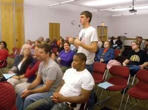 Young man speaking at the auditorium of the Champaign Public Library