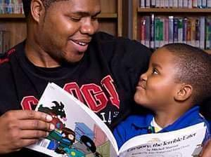 Shony Coleman reading to his son