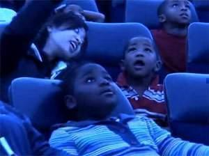 Head Start children look up to view planetarium show