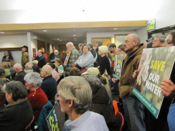 Opponents of the proposed coal mine in Homer gather at Monday night's village board meeting.