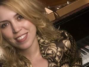 Gabriela Montero in front of piano