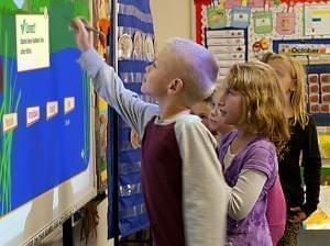 Students in Gibson City use a white board to play a learning game.