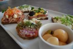 A table displaying several types of open faced sandwiches.