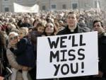 A priest displays a placard in St. Peter's Square at the Vatican