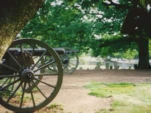 Cannons at Gettysburg with grave markers in background