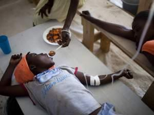 Child getting treatment for cholera in Haiti.