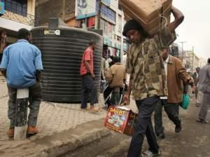 People walk down a market street in Eastleigh