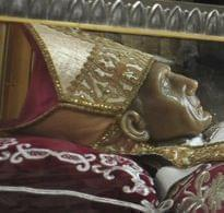 Pope Benedict XVI stands by remains of Pope Celestine V.