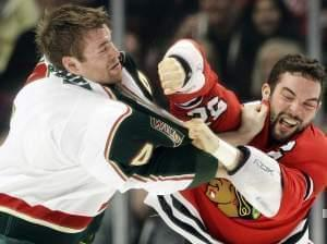 A fight between Chicago Blackhawks player Brandon Bollig and Minnesota Wild's Clayton Stoner.