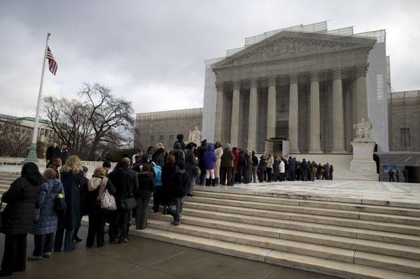 People wait in line outside the Supreme Court in Washington, Wednesday, Feb. 27,2013, to listen to oral arguments in the Shelby County, Ala., v. Holder voting rights case.