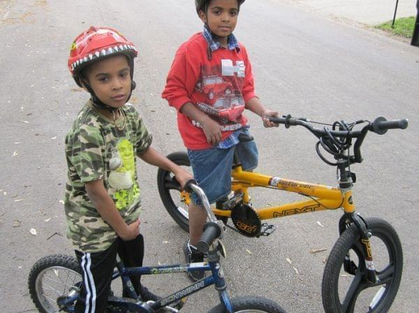 Mark Smith, 7, and his brother Tauryon Smith, 11, pose next to their bicycles in Champaign.