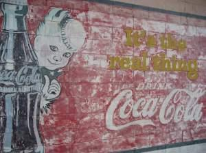 A Coca-Cola mural in Vicksburg, Miss., where the soda was first bottled in 1894. Mississippi's governor is expected to sign a bill that would prevent the regulation of soda portion sizes by counties or towns.