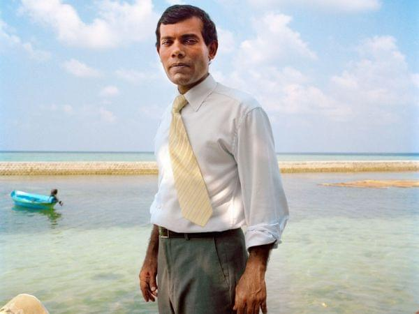 Mohamed Nasheed, the first democratically elected president of the Republic of Maldives, standing on the shore