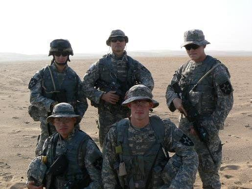 Eric (pictured on the far right) with friends in Kuwait in 2006 shortly before going to Iraq.