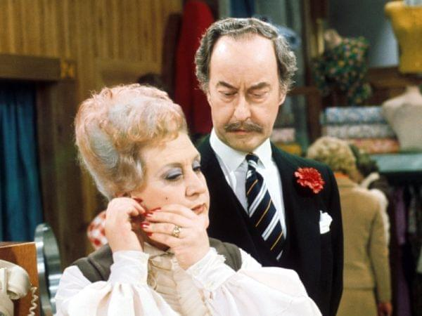 Captain Peacock looks disapprovingly at Mrs. Slocombe.