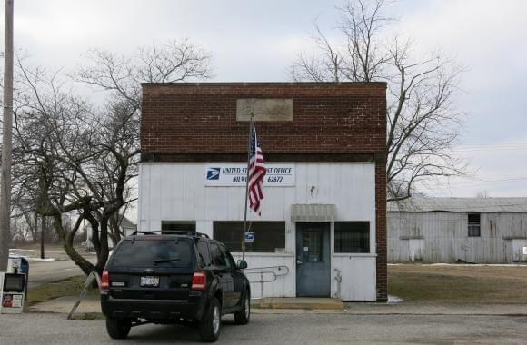 The post office in Nilwood, Ill., serves as an informal community center.