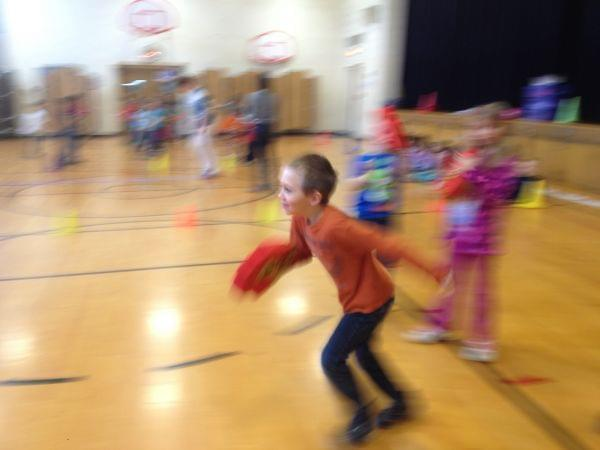 student at Wiley Elementary running during gym class