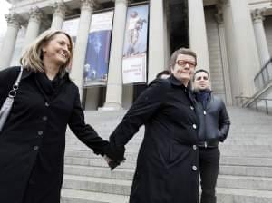Sandy Stier, left, and Kris Perry of Berkeley, Calif., arrive at the National Archives in Washington, Monday, March 25, 2013, to view the U.S. Constitution, a day before their same-sex marriage case is argued before the Supreme Court.