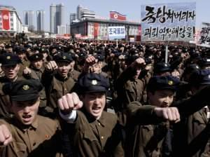 University students march through Kim Il Sung Square in downtown Pyongyang, North Korea, on Friday.