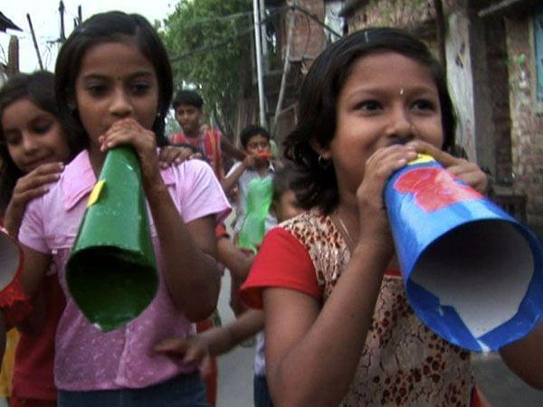 Child activists in Calcutta spreading health messages with megaphones.
