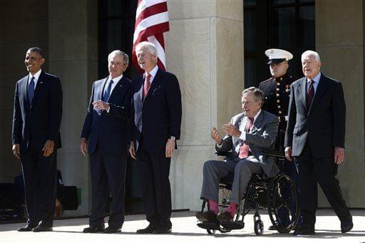 President Barack Obama stands with, from second from left, former presidents George W. Bush, Bill Clinton, George H.W. Bush, and Jimmy Carter at the dedication of the George W. Bush presidential library on the campus of Southern Methodist University