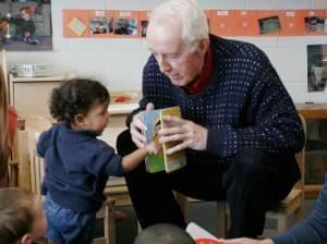 George Willhite reading to toddlers
