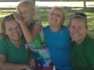 Katie Nolan is pictured on the far left with campers at Camp Peairs near Bloomington.