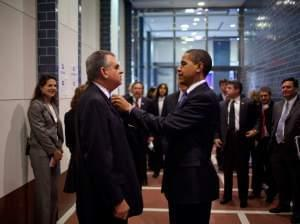 President Barack Obama fixes the tie of Transportation Secretary Ray LaHood