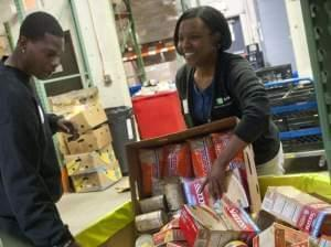Volunteers sort donated food into barrels at the Manna Food Center in Gaithersburg in Montgomery County, Md. Poverty in the county, just outside of Washington, D.C., has grown by two-thirds since 2007.
