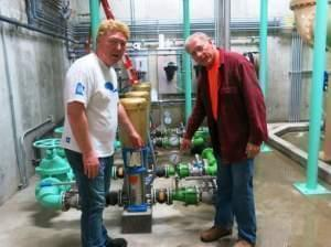 Staunton, Ill., Mayor Craig Neuhaus (left) checks out the town's new water plant with Hank Fey, a public works director.