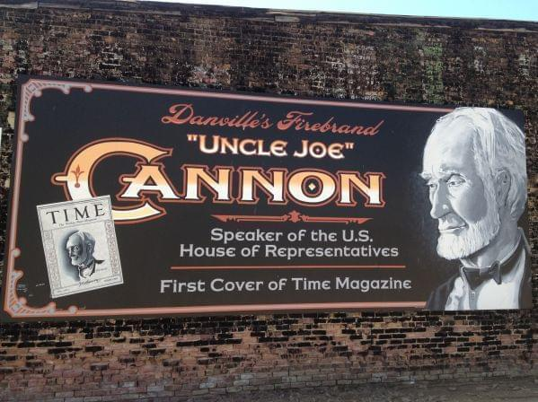 "A painted mural of ""Uncle Joe"" Cannon on the side of a building in downtown Danville at the corner of Harrison and Vermilion streets depicts the Time Magazine cover he was featured on."