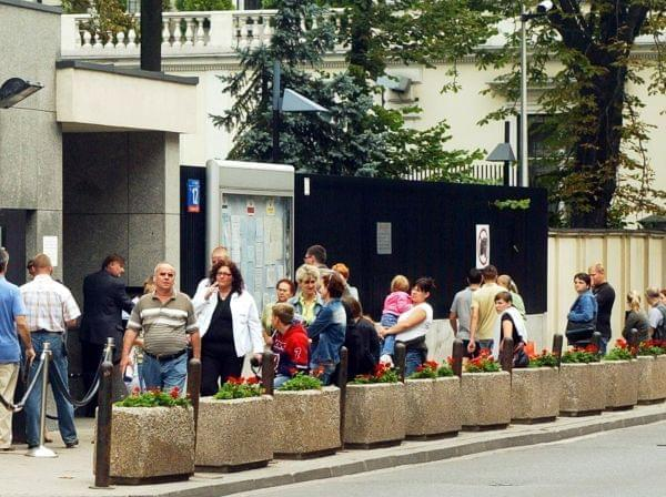 Poles line up in front of the Visa Section of the U.S. Embassy in Warsaw, Poland, Tuesday, Aug. 14, 2007.