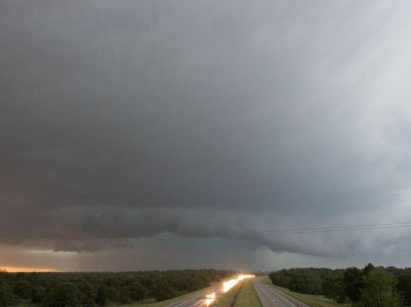 A tornado forms over I-40 as seen looking west from Indian Meridian Road in Midwest City, Okla. on Friday.